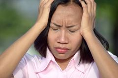 Woman And Anxiety. A pretty asian adult female royalty free stock photography