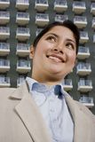 Woman and apartments Stock Photography