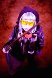 Woman apocalypse killer holding Japanese sword. Woman apocalypse killer holding а Japanese sword stock photos