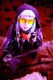 Woman apocalypse killer holding Japanese sword. Woman apocalypse killer holding a Japanese sword stock photo