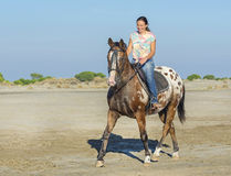 Woman and appaloosa horse Royalty Free Stock Images