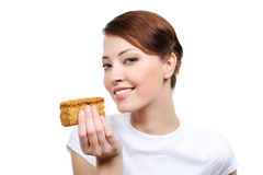 Woman with appetizing cake. Beautiful young woman with appetizing cake  -  isolated on white Royalty Free Stock Image