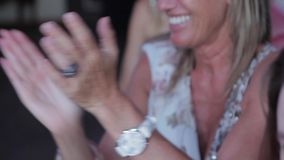 Woman applauding at an event. stock video footage