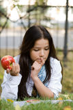 Woman with apple Stock Image