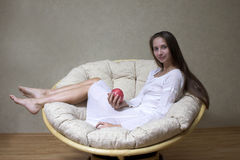 Woman with apple. Pretty smiling woman with red apple. Portrait Royalty Free Stock Image