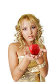 Woman and apple. Young attractive woman in golden dress holding red apple stock photography