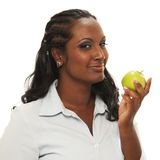 Woman with apple. Looking healthy Royalty Free Stock Photos