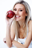 Woman with apple Royalty Free Stock Image