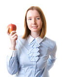 Woman with an apple. Young woman in formal wear holding apple in her hand, isolated on white Stock Images