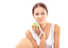 Woman with apple Stock Images