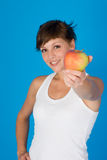 Woman with a apple. A woman with a apple Stock Photo