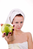Woman with apple. Beautiful young woman with green apple. Isolated on white background Royalty Free Stock Images