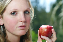 Woman with apple. Young woman holding red apple Royalty Free Stock Photography