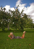 Woman and apple. Laying under apple tree Stock Photos