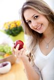 Woman with an apple Royalty Free Stock Images