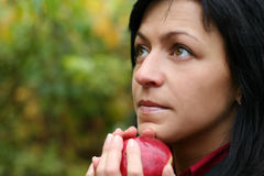 Woman and apple in autumn park stock image