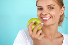Woman With Apple. Beautiful Girl With White Smile, Healthy Teeth Royalty Free Stock Photography