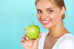Woman With Apple. Beautiful Girl With White Smile, Healthy Teeth Stock Photos