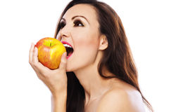 Woman apple bites. Nude woman beautiful attractive profile long dark hair yellow apple bites Stock Image
