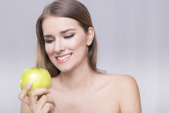 Woman and apple Stock Photos