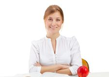 Woman with apple and book Stock Images