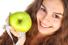Woman with apple and centimeter Royalty Free Stock Photos