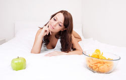 Woman with apple and chips Royalty Free Stock Photo