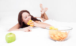 Woman with apple and chips Royalty Free Stock Photos