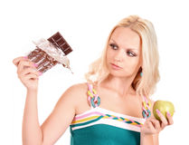 woman with apple and  chocolate Royalty Free Stock Photo