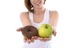 Woman with Apple and Chocolate Donut in Hands Royalty Free Stock Images