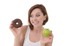 Woman with Apple and Chocolate Donut in Hands Royalty Free Stock Photos
