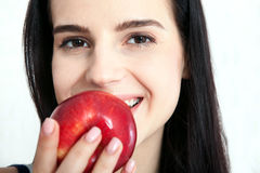 Woman with apple close-up face. Beautiful women exists to clean skin on the face. Asian woman. Stock Photos