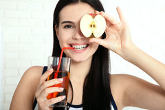 Woman with apple close-up face. Beautiful women exists to clean skin on the face. Asian woman. Stock Image