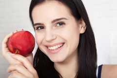 Woman with apple close-up face. Beautiful women exists to clean skin on the face. Asian woman. Stock Photography