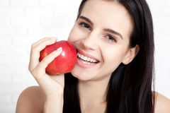 Woman with apple close-up face. Beautiful women exists to clean skin on the face. Asian woman. royalty free stock images