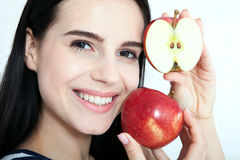 Woman with apple close-up face. Beautiful women exists to clean skin on the face. Asian woman. royalty free stock photos