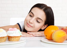 Woman with apple close-up face. Beautiful women exists to clean skin on the face that chooses to eat an apple or cake. Asian woman Royalty Free Stock Images