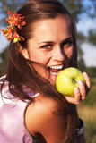 Woman with apple with flower Royalty Free Stock Photo