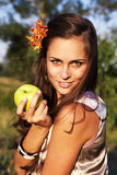 Woman with apple with flower Stock Photos