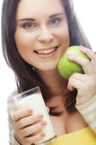 woman with  apple and a glass of milk Stock Photo