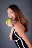Woman with apple on the grey background Stock Images