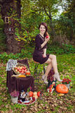 Woman with an apple in the hands in autumn park Stock Photos