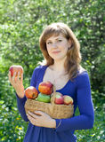 Woman with apple harvest in garden Stock Photo