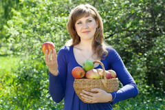 Woman with apple harvest in orchard Royalty Free Stock Photo