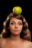 Woman with apple on head Stock Photography
