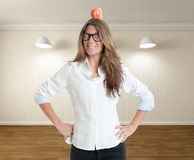 Woman with apple on her head Stock Photos