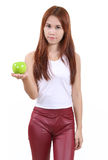 Woman and apple. Image of portrait young woman with an apple on white background Royalty Free Stock Photography