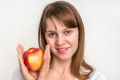 Woman with apple isolated on white - healthy diet concept Royalty Free Stock Photo
