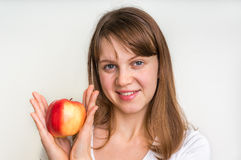 Woman with apple isolated on white - healthy diet concept Stock Photo