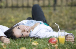Woman with apple and juice at the summer park Stock Photography